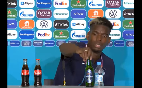 Paul Pogba, a Muslim football player, removing a Heineken bottle from the conference table during a Euros 2020 conference